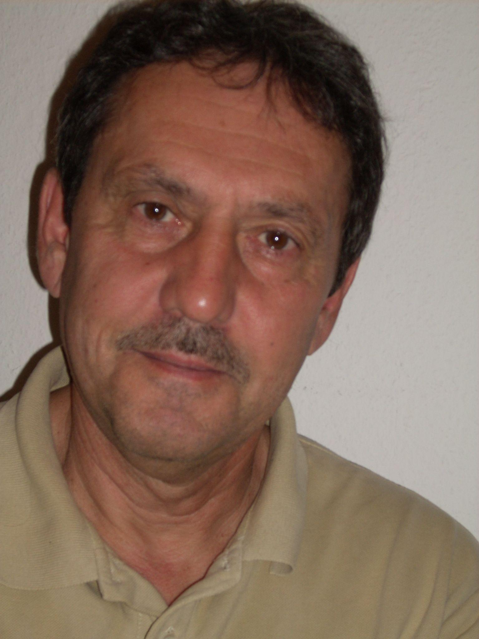 Dr. Tallos Péter